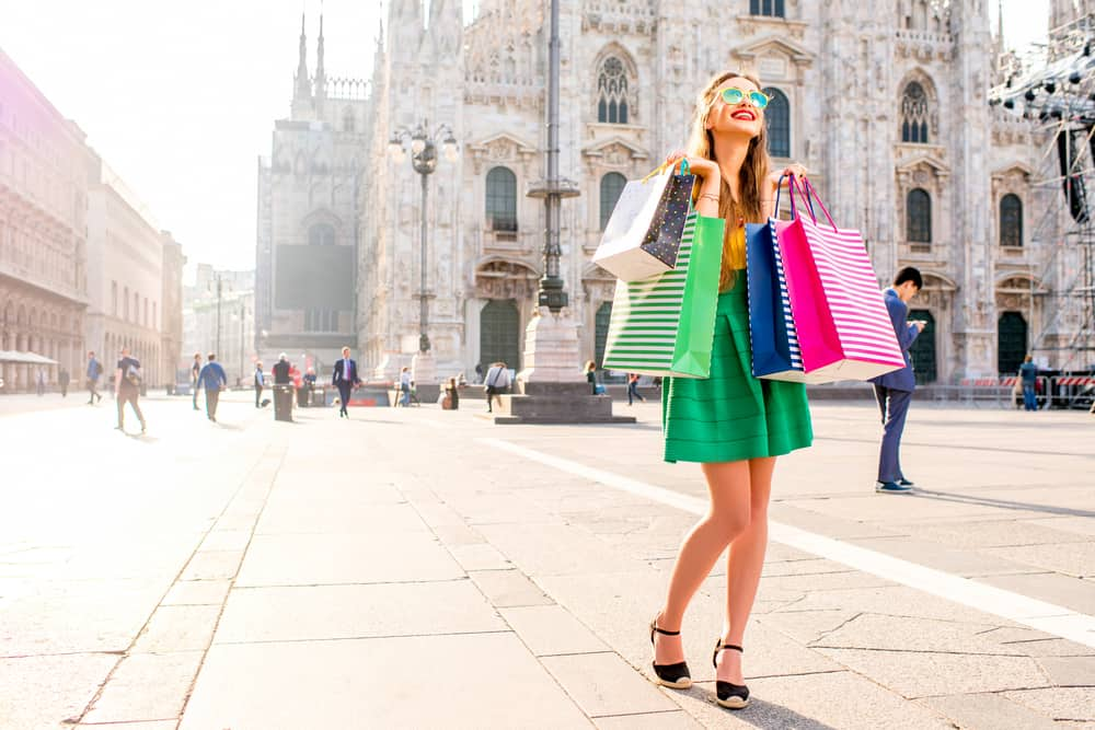 A woman shopping outside the Milan Cathedral. There are so many great choices of where to stay in Milan