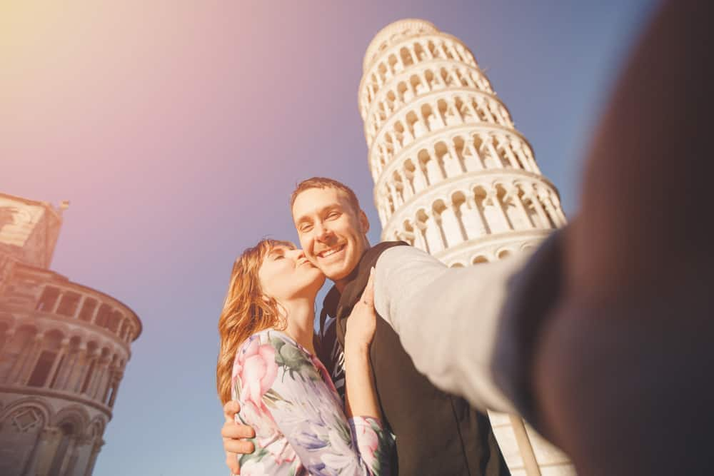 Photo of couple in Pisa, looking almost as happy as you will during your own Tuscany honeymoon.