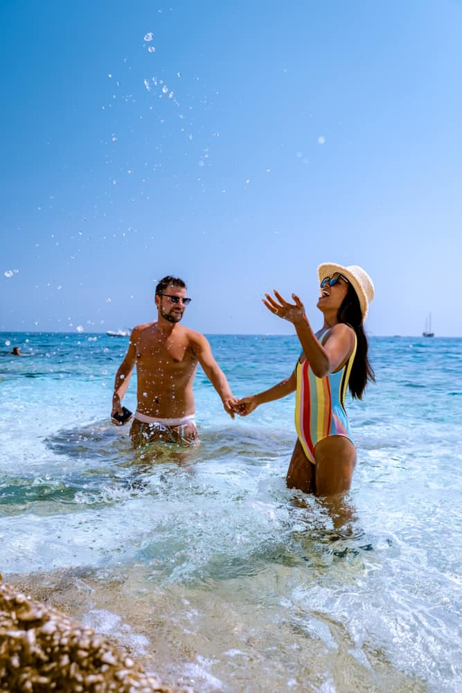 Photo of couple at Italian beach.