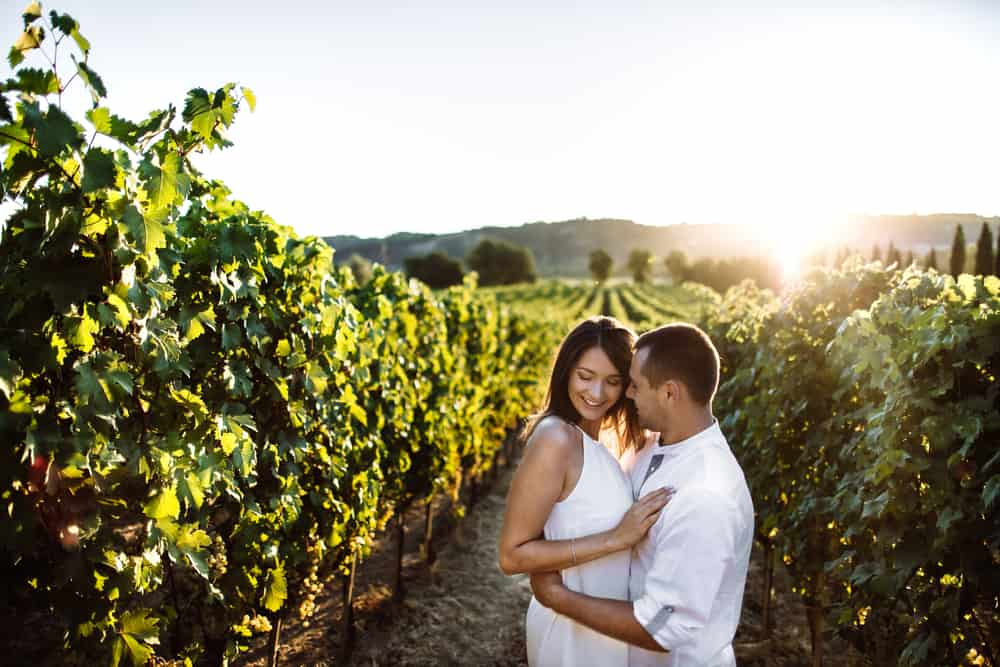 Photo of couple in a vineyard in Tuscany.