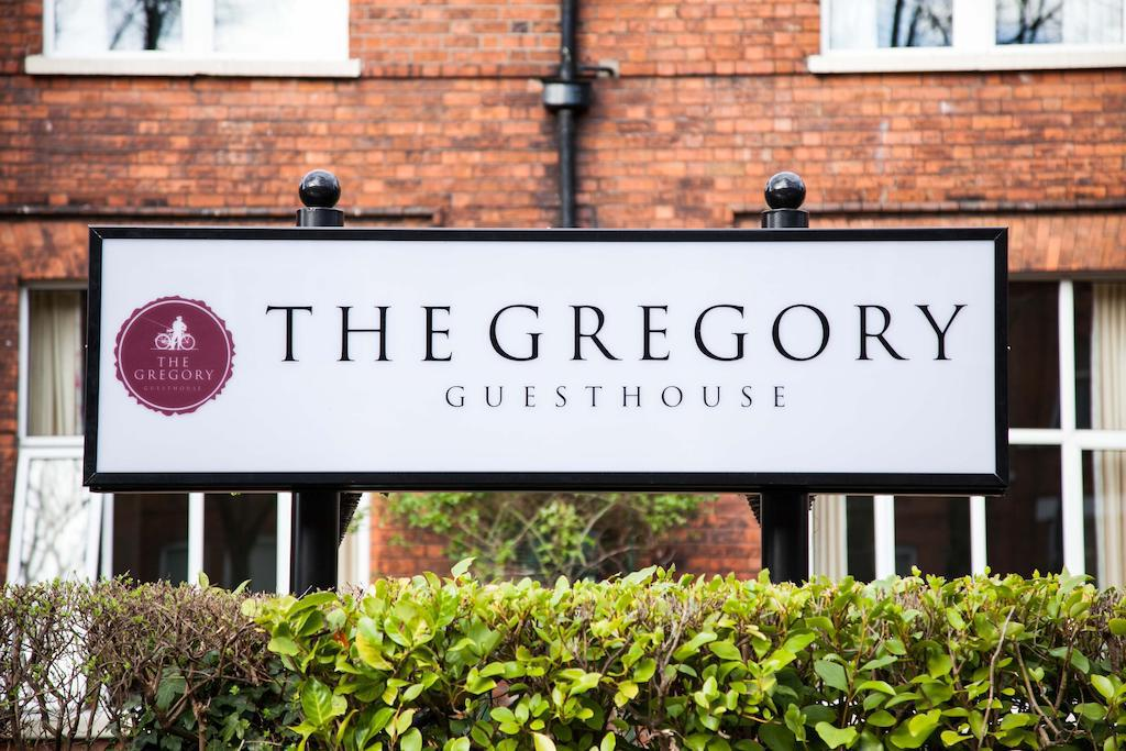 Photo of the welcome sign for the Gregory Guesthouses, a fun place to stay during your Ireland honeymoon.