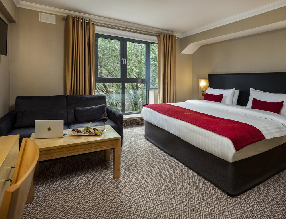 Relax in the comfortable rooms at Academy Plaza
