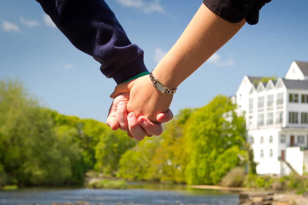 Photo of couple holding hands in Ireland.