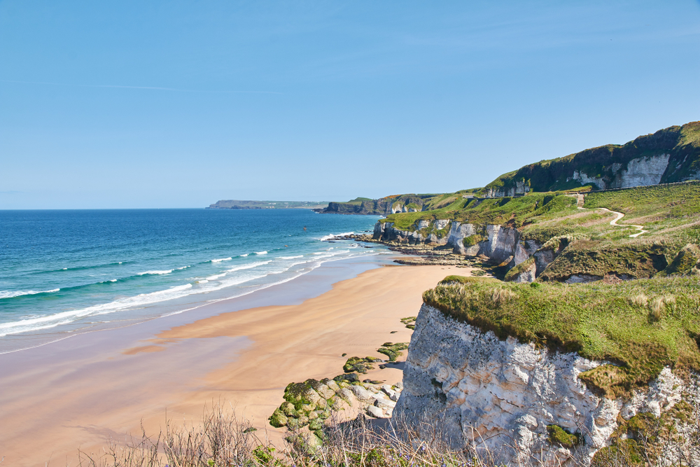 Photo of Portrush White Rocks Beach, a stunning beach to visit during your Ireland honeymoon.