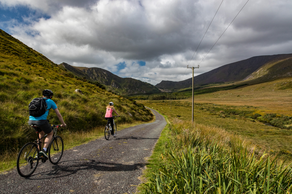Photo of couple riding bikes in Ireland.