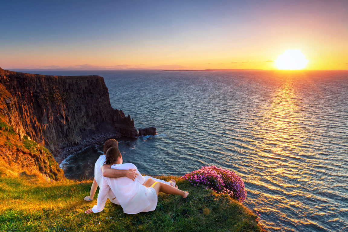 Photo of a couple on a cliff-side.