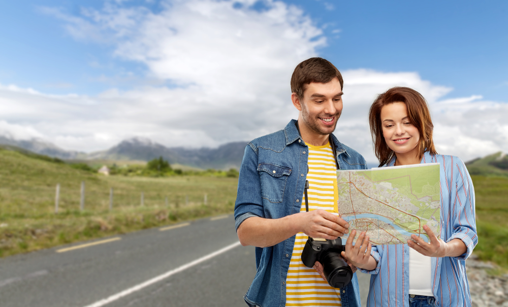 Photo of couple in Ireland with a map.