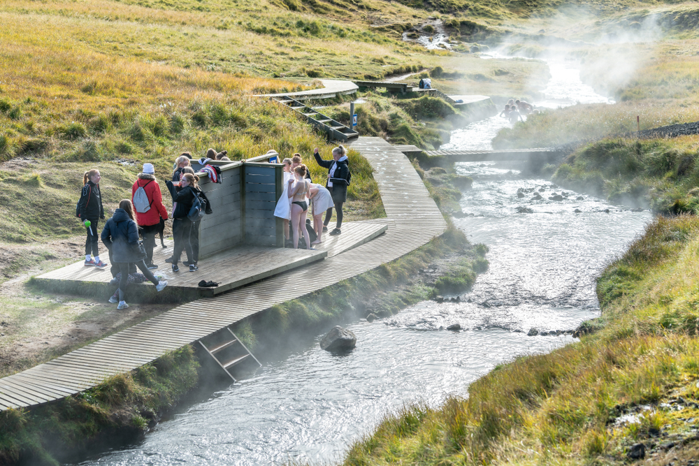tourists visiting the Reykjadalur Hot Springs during your 4 days in Iceland