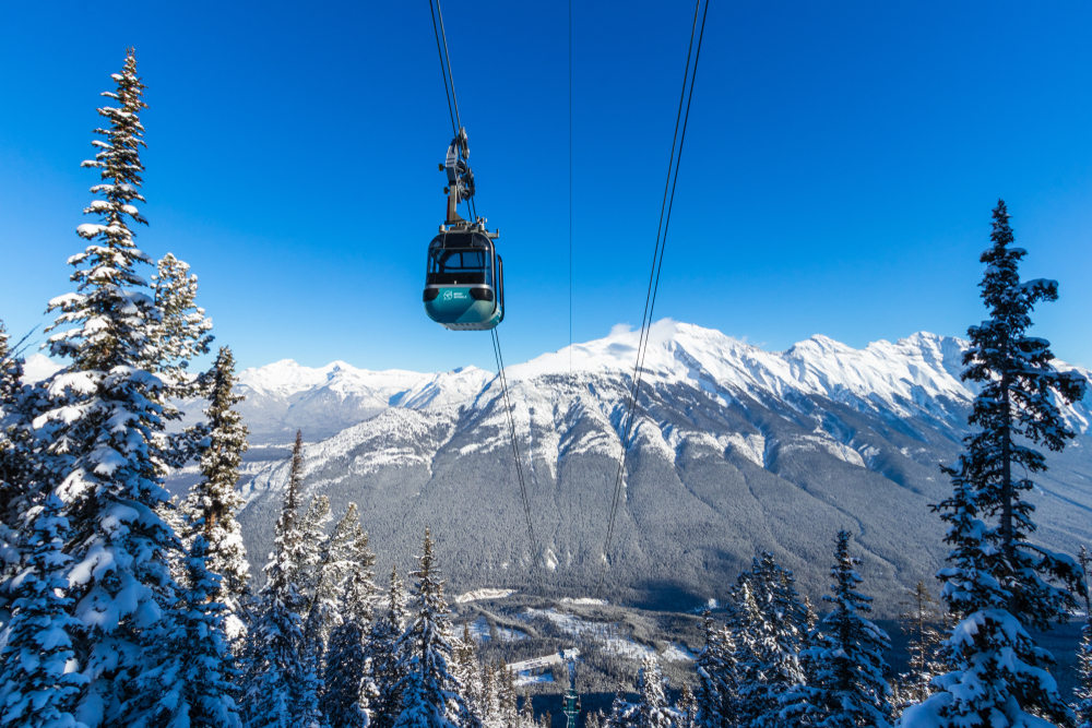 Take a gondola to Mountain tops in Banff in winter!