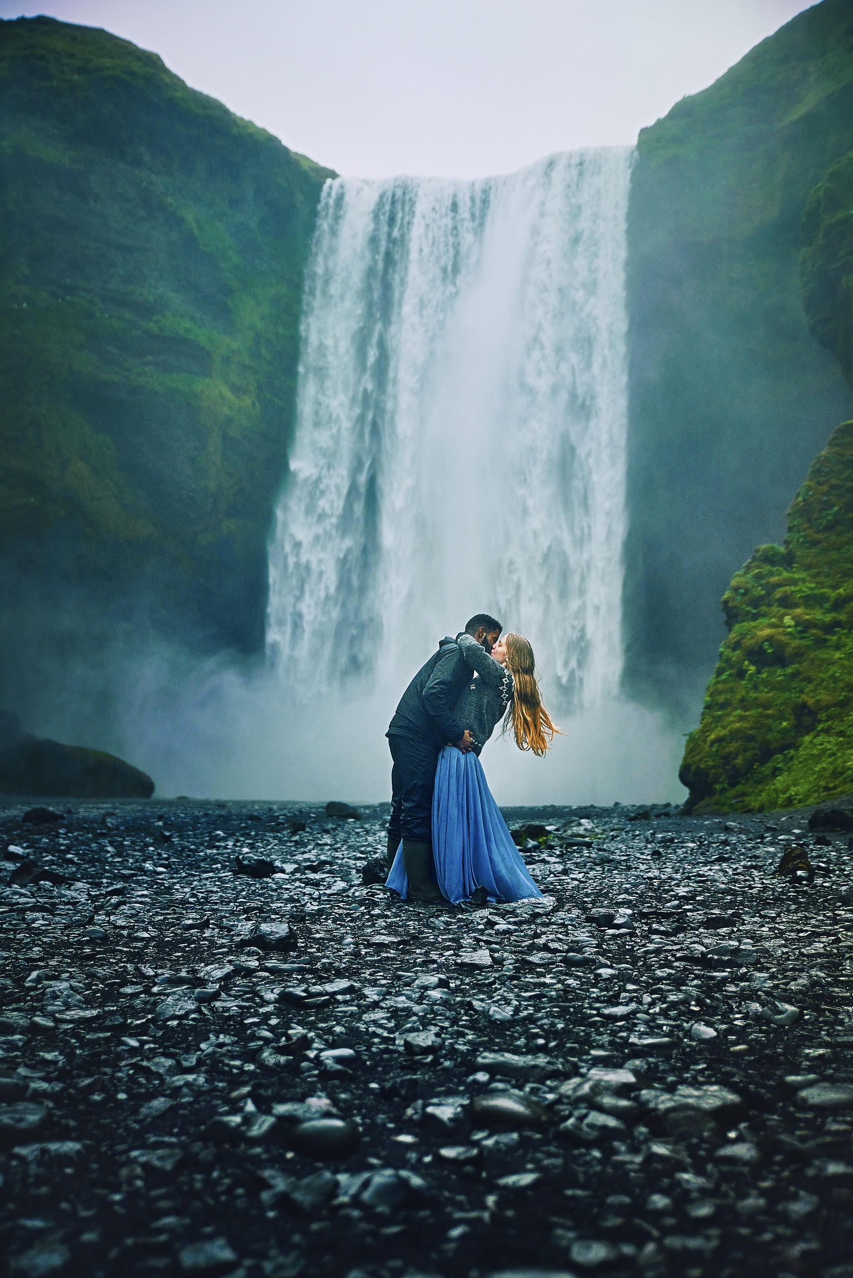 Photo of Terrence and Victoria by a waterfall in Iceland.