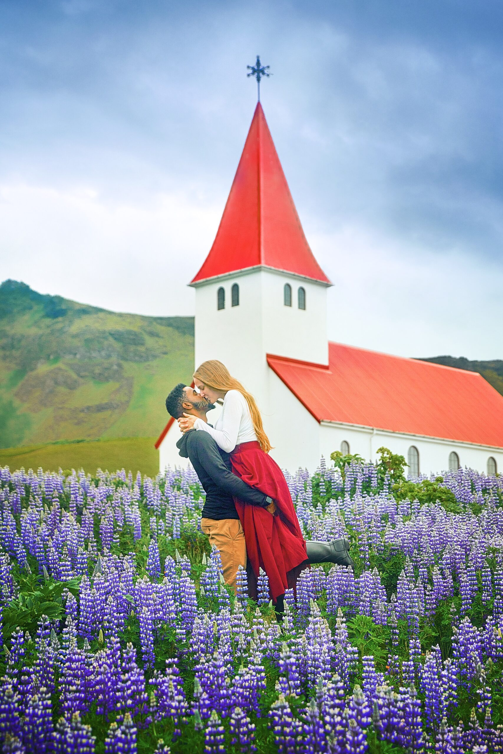 Photo of Victoria and Terrence in front of church in Iceland.