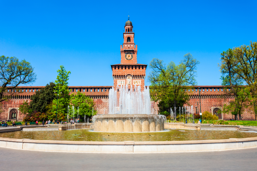 red colored building with fountain in front Northern Italy Itinerary