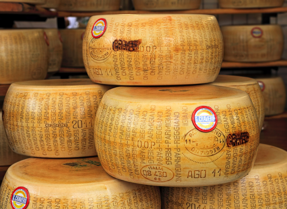 wheels of Parmesan cheese Northern Italy itinerary