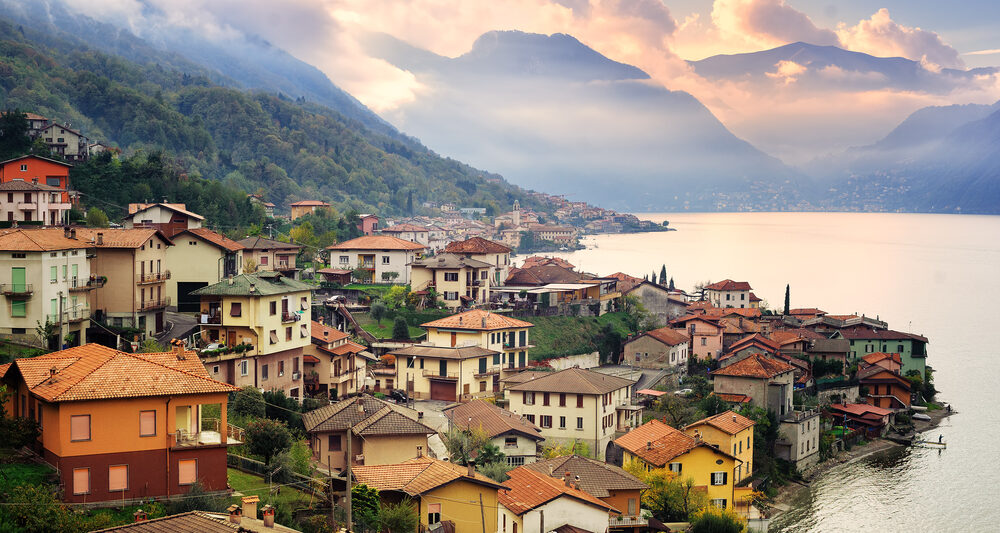 picturesque Lake Como houses on lake during sunrise