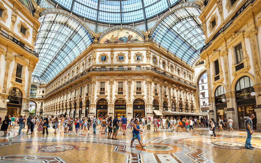 beautiful interior of Milan Galleria with golden accents and glass roofing