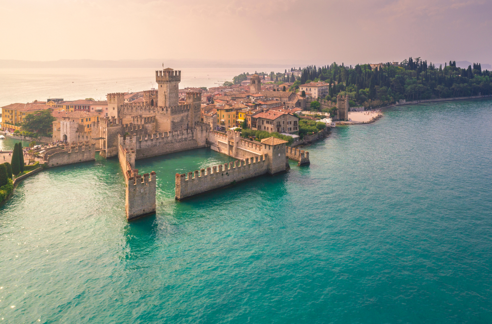 aerial view of Scagliero Castle on the water Northern Italy itinerary