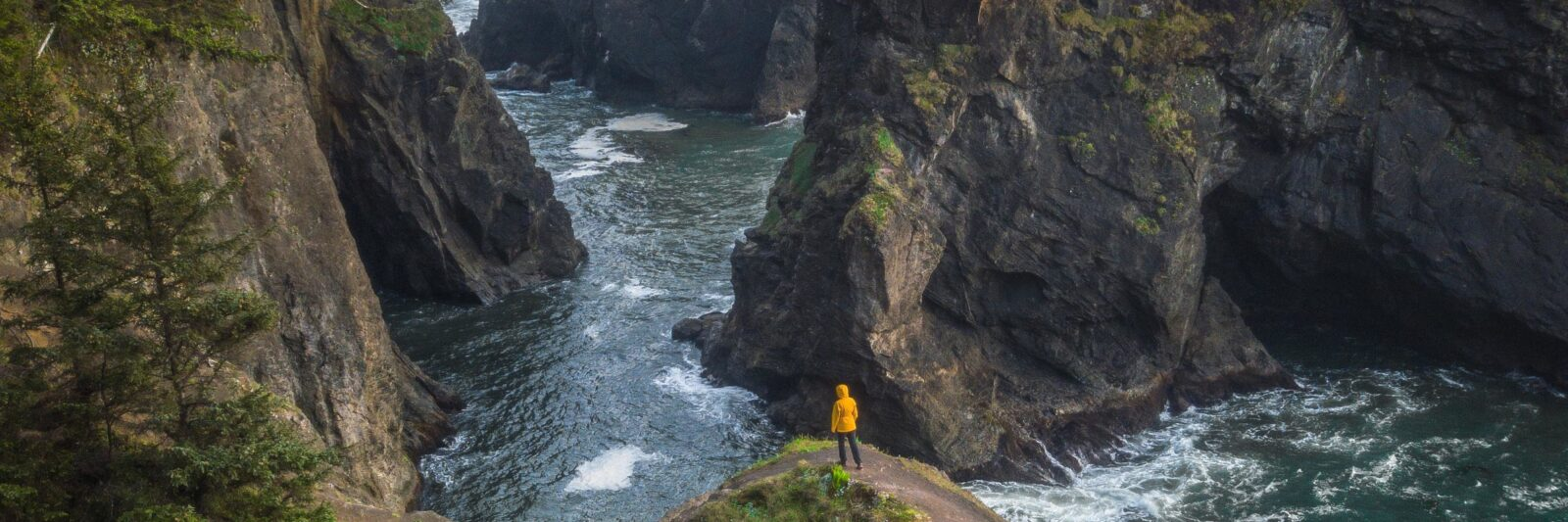walking on a natural bridge at the Samuel H Boardman Scenic Corridor on your Oregon coast road trip