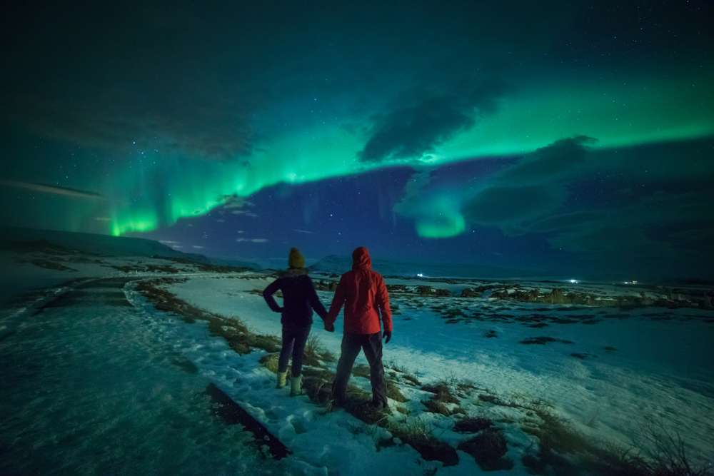 Photo of couple viewing the Northern Lights in Iceland