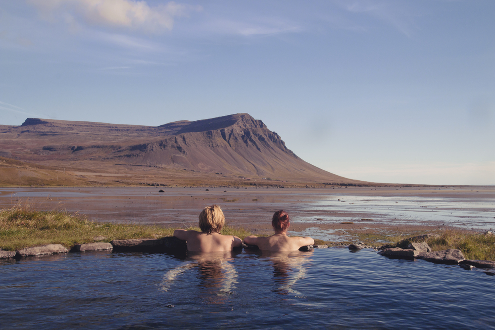 Photo of couple in hot spring in Iceland.