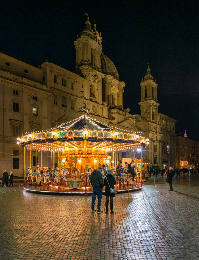 Christmas market at night with carousel 7 days in Italy