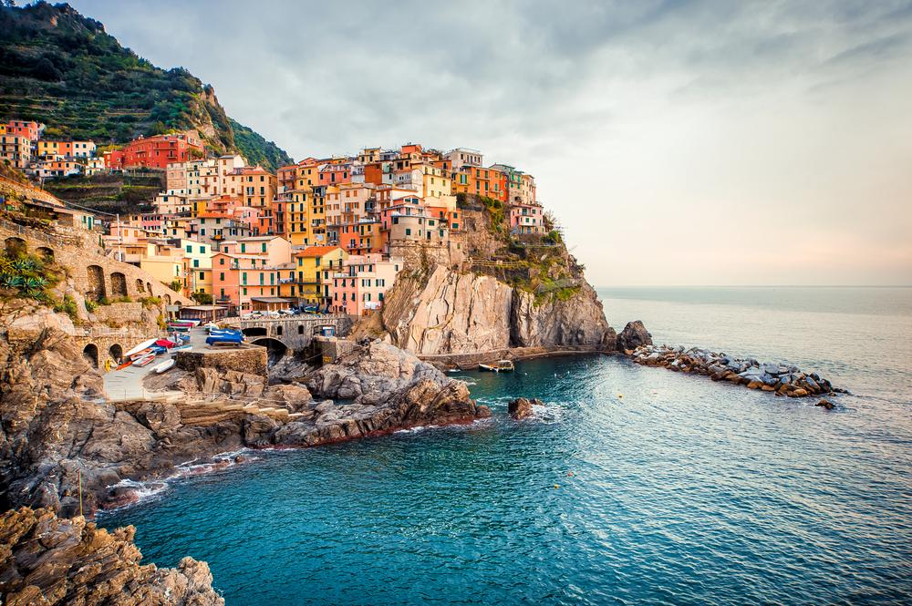 colorful buildings of Cinque Terre on water 7 days in Italy