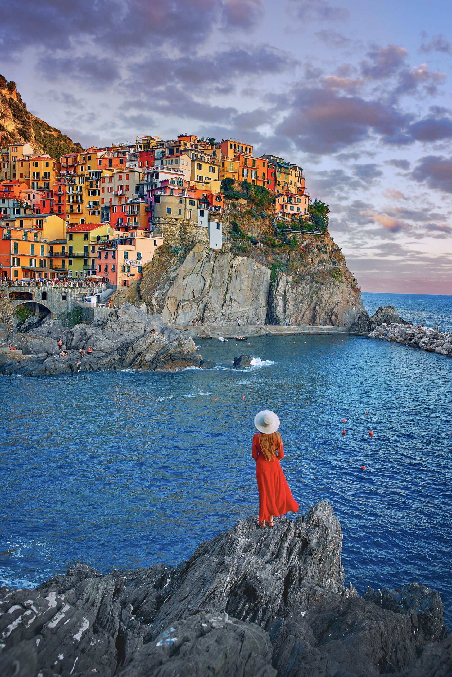 woman standing in front of colorful Cinque Terre buildings