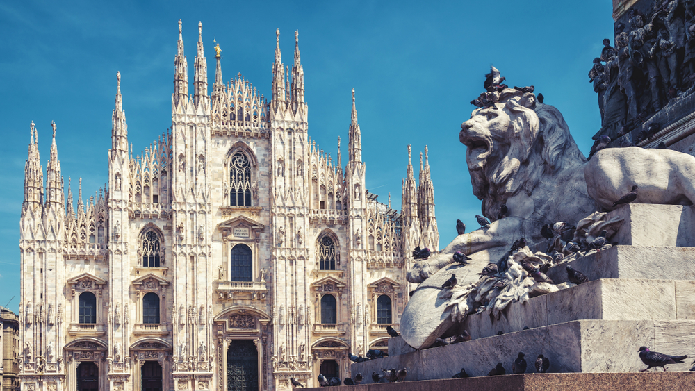 Milan cathedral with lion statue in front
