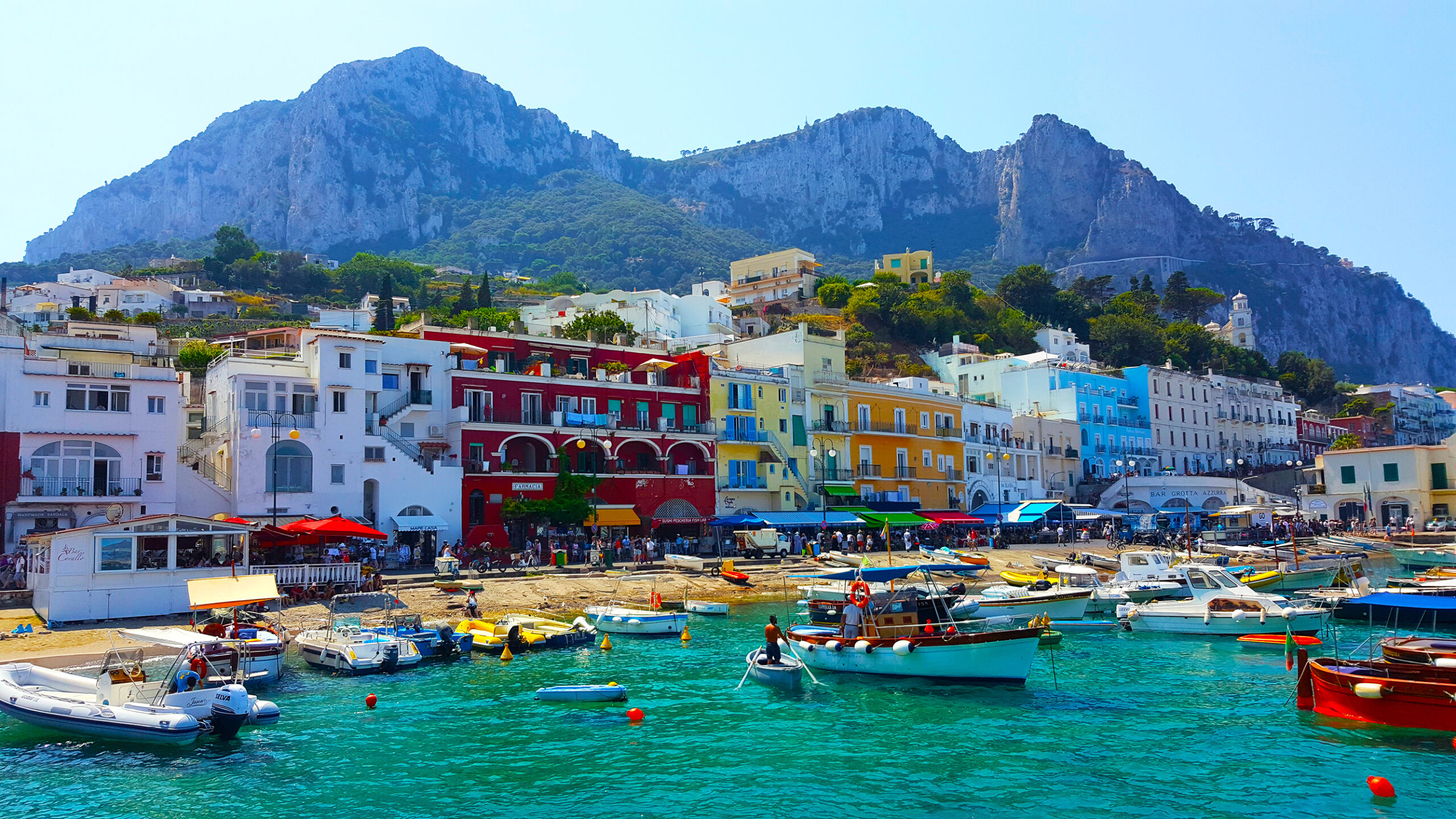 Photo of Marina Grande of Amalfi showing fishing boats and colorful buildings.