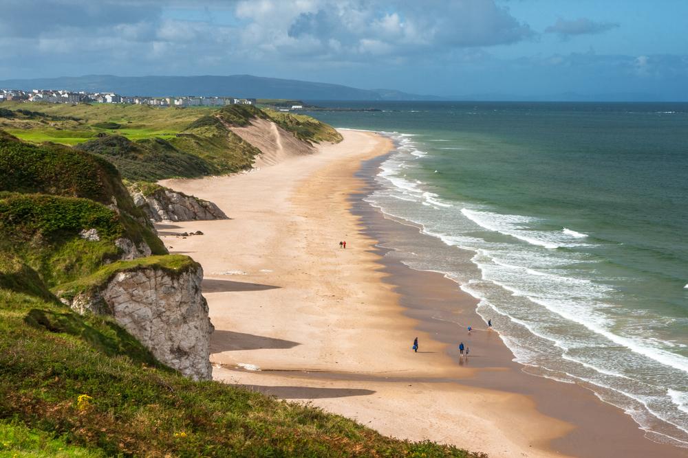 The dazzling beach lined by limestone cliffs at Portrush Whiterocks Beach in Ireland