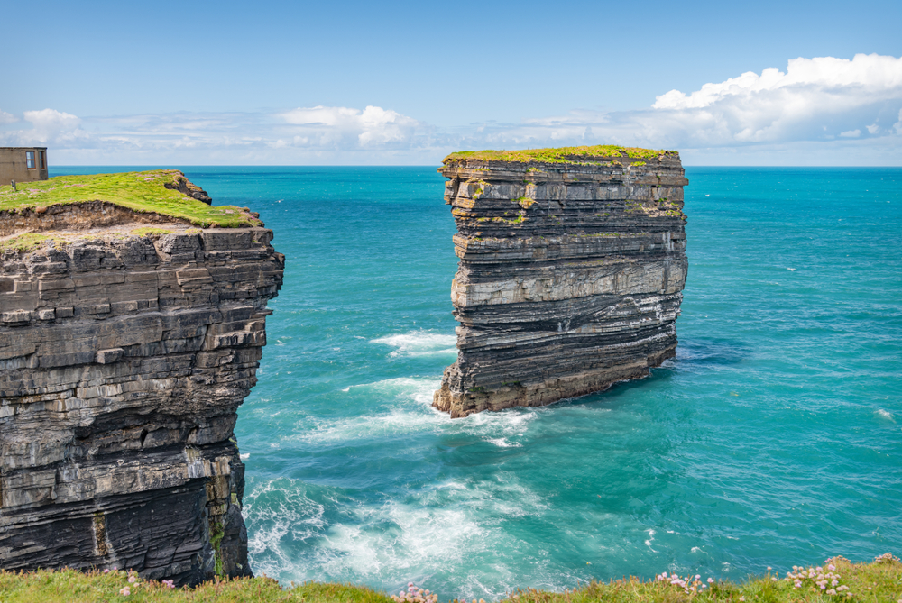 Sea stack at Downpatrick Head on a clear day in Ireland.
