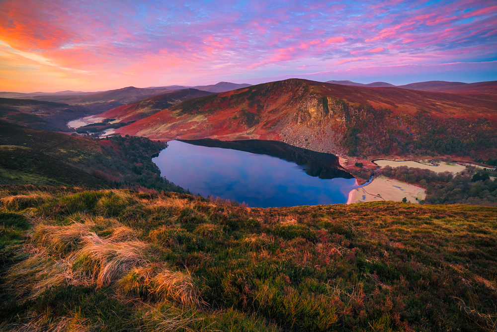 Wicklow mountains and lake during colorful sunset