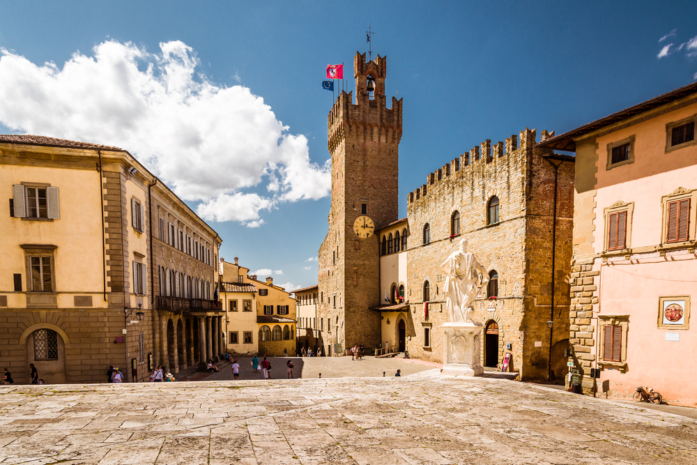 empty, medieval square in Italy Day trips from Florence