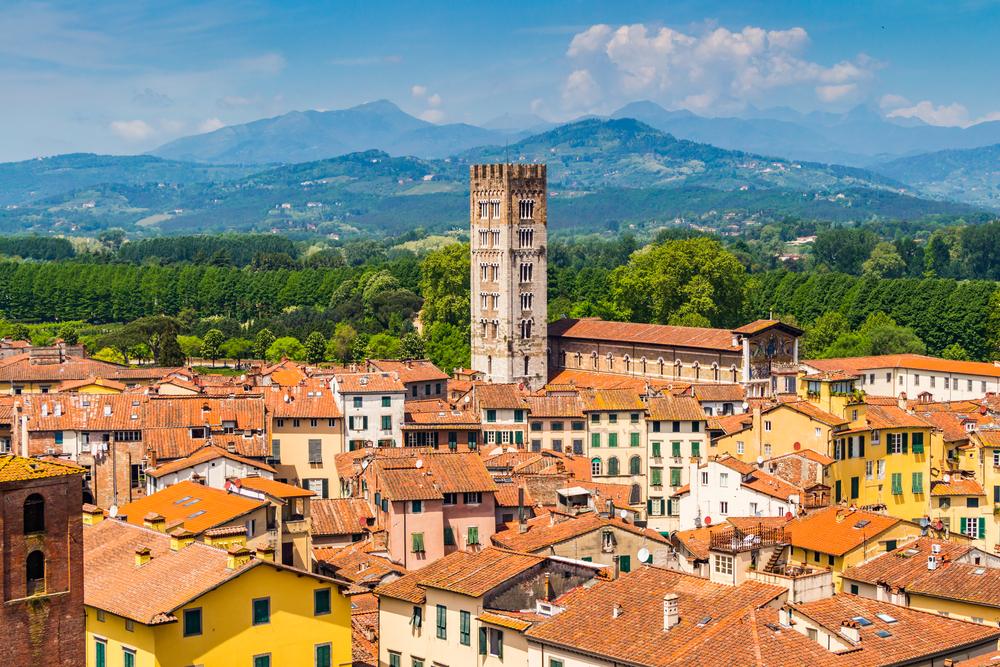 Lucca city with tower and mountains in background