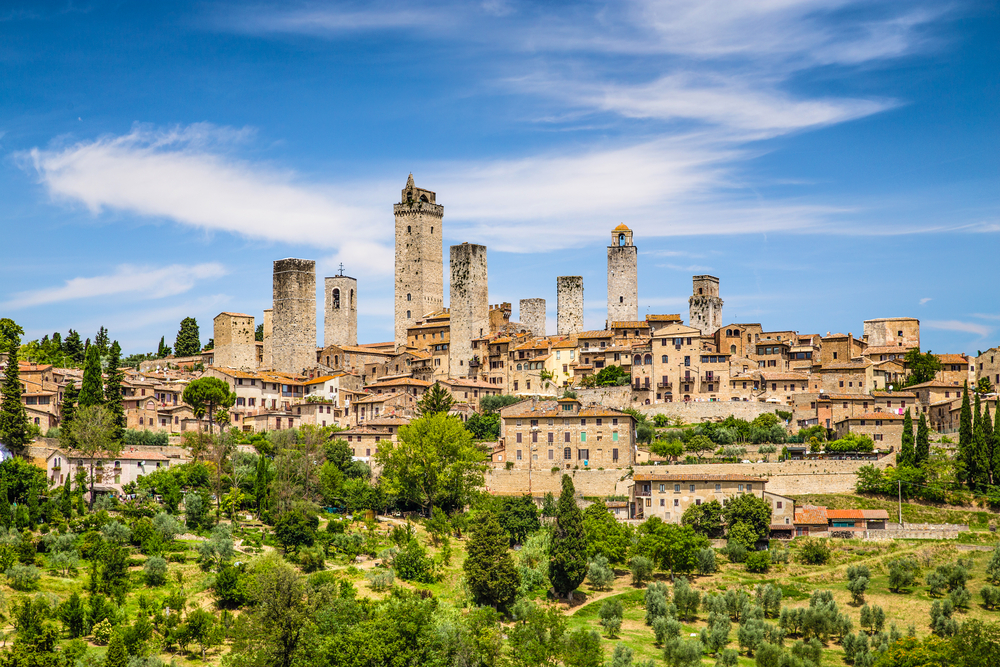historic city on top of green hill day trips from Florence