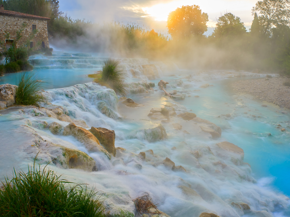 teal steaming waters in hot spring day trips from Florence