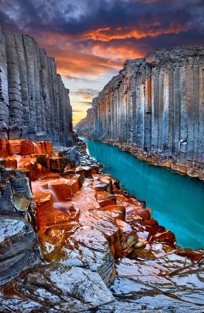 Iceland Canyon Studlagil Basalt Canyon with colorful stone and blue river | basalt canyon in Iceland with glacier river