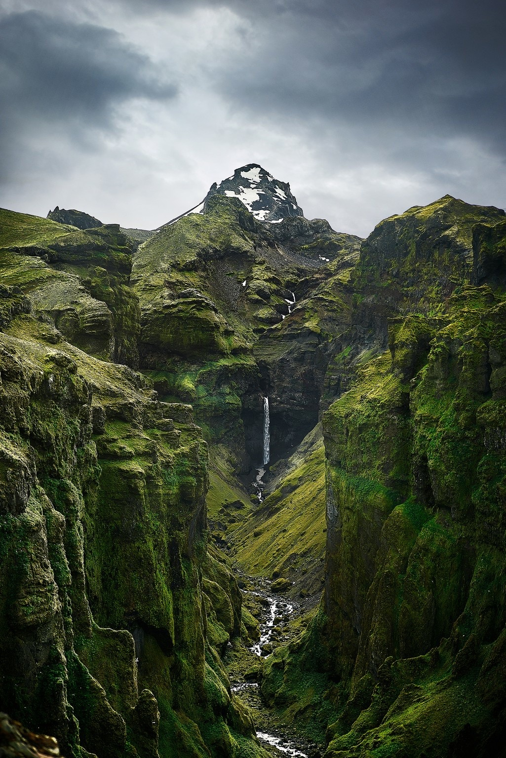 Iceland Canyons Mulagljufur Canyon with waterfall and mountain | canyon in Iceland with a waterfall coming out of a mountain