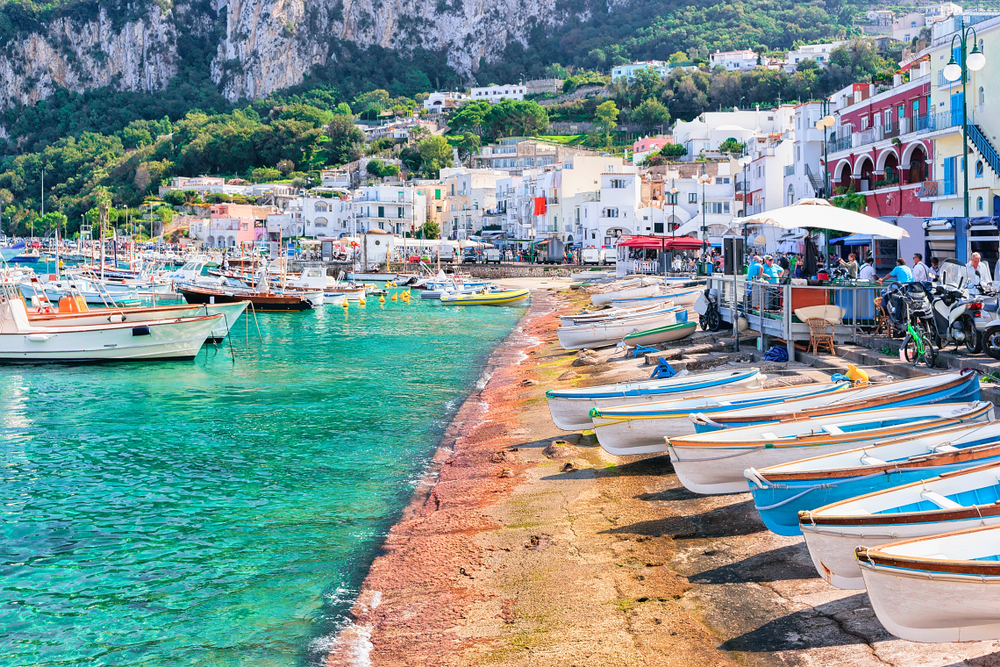 Boats lining the city streets in Capri, one of the prettiest beach towns in Italy.