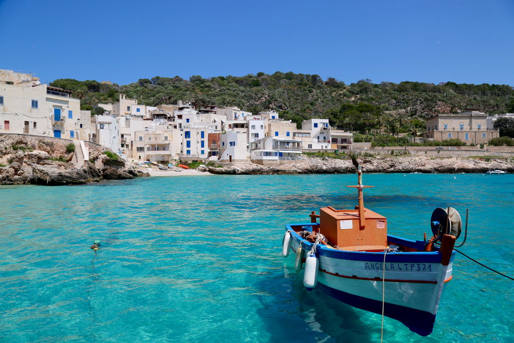 Boat in the harbor of Levanzo, one of the prettiest beach towns in Italy.