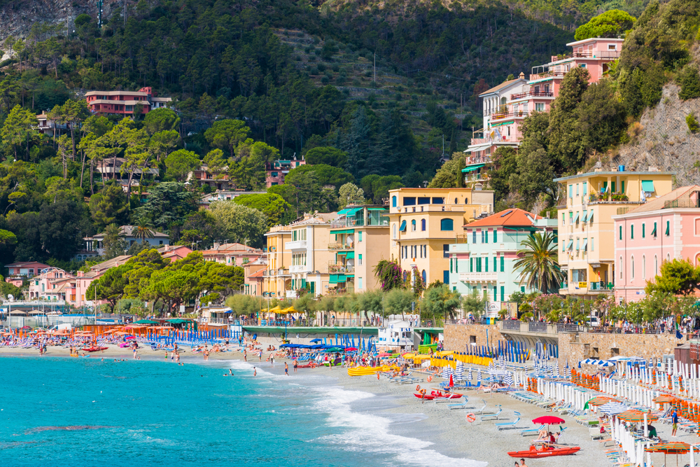 Sea meeting a busy beach in the Italian beach town, Monterosso al Mare.