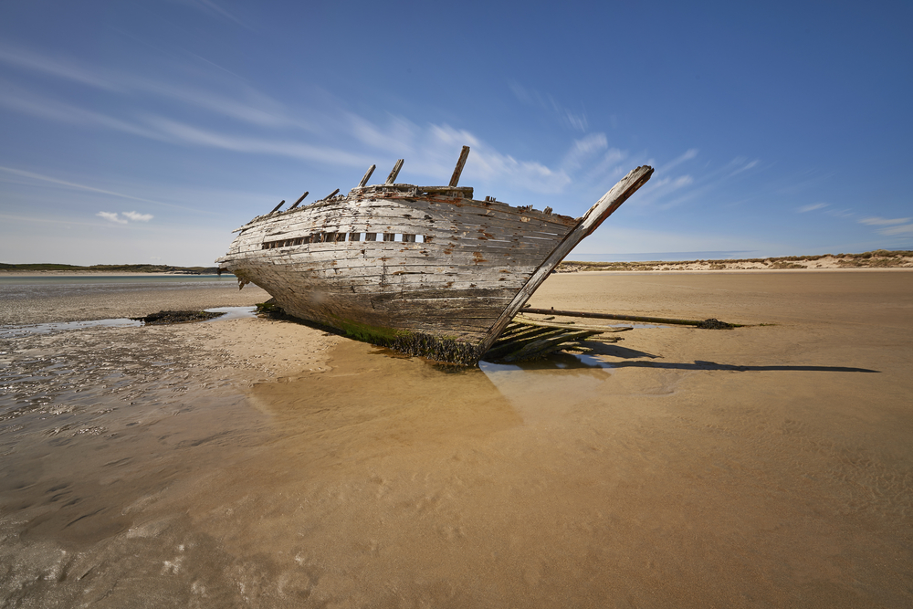 Eddie's Boat shipwreck beached on the sand