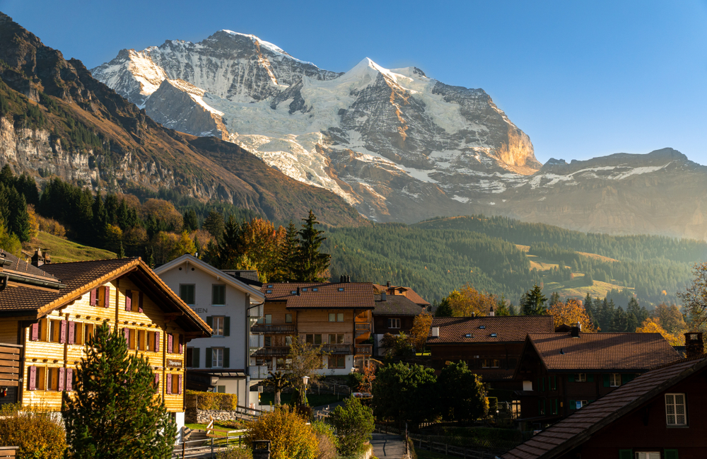 A beautiful small town in Switzerland typical Swiss chalets and a mountain backdrop
