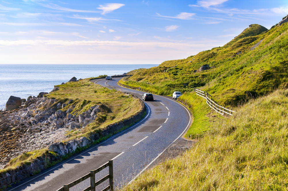 A car driving along coastal Ireland.