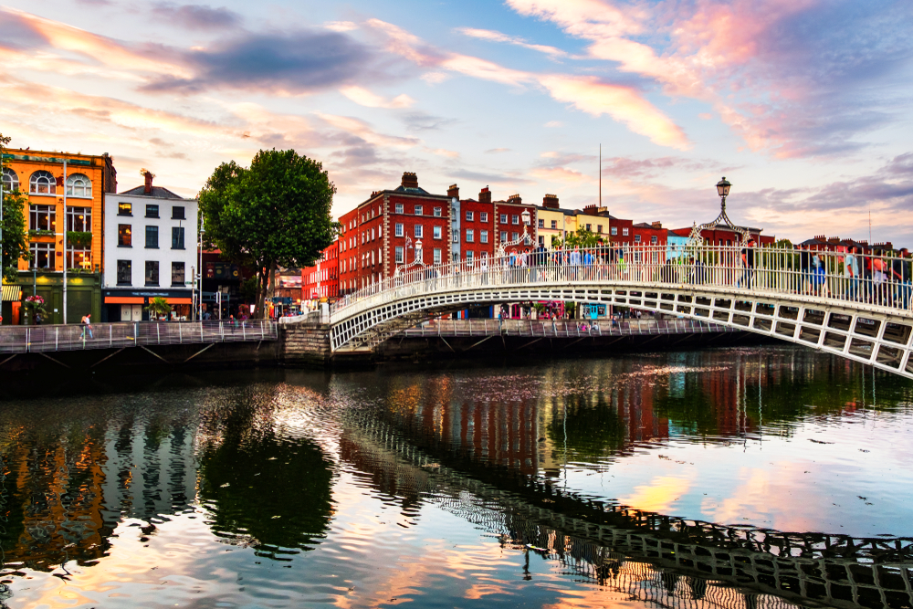 A view over halfpenny Bridge in Dublin at sunset.