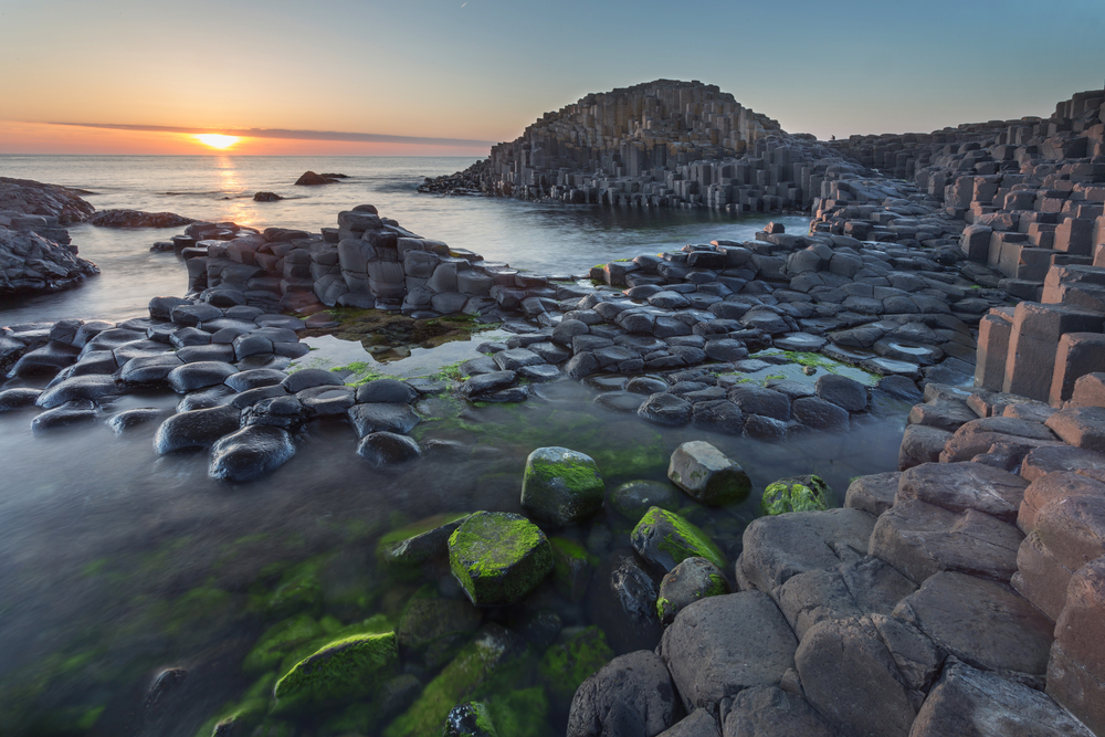 Giants Causeway in Northern Ireland where some fly into to save on their trip to Ireland cost.