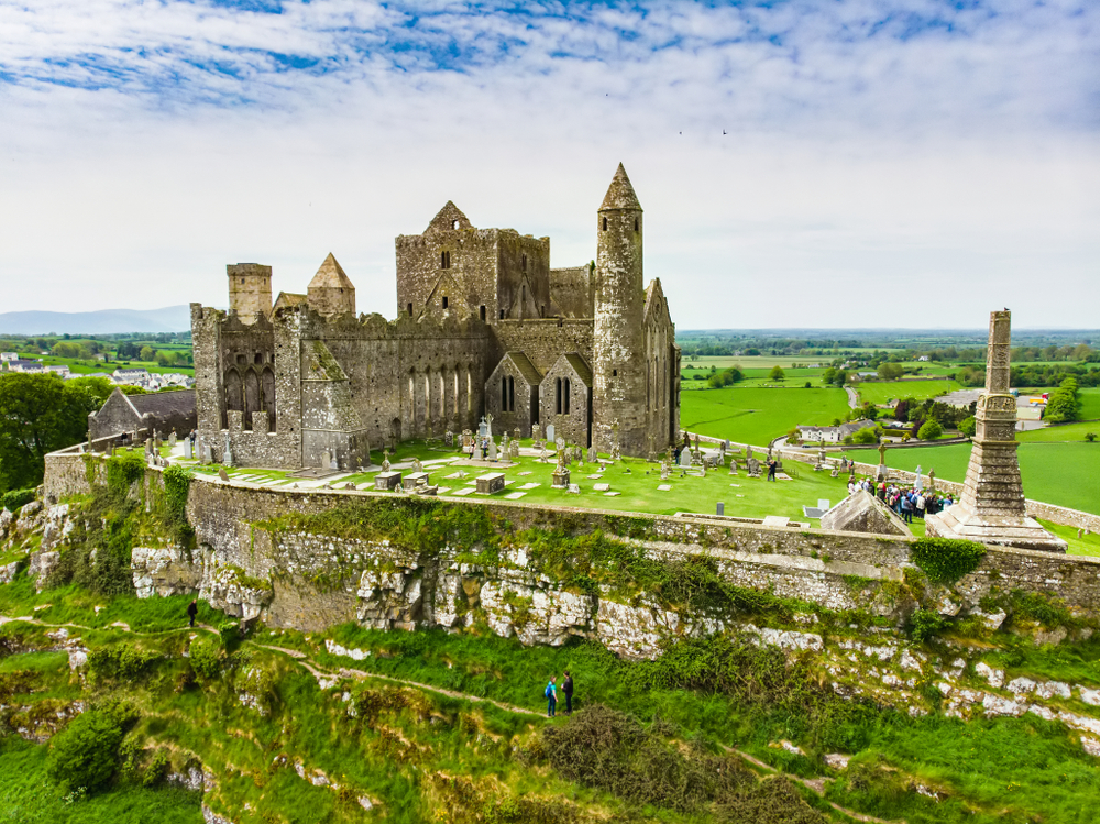 The Rock of Cashel seen from across a pasture.
