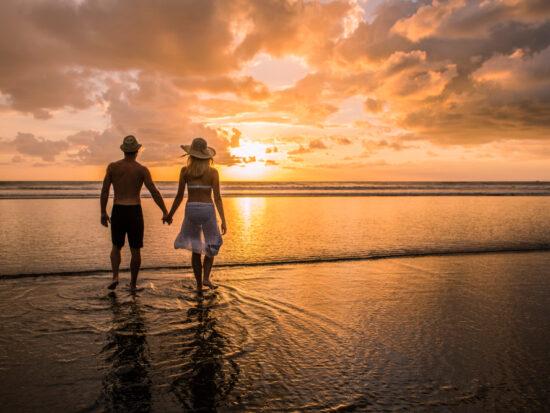 couple enjoying sunset on the beach on their costa rica honeymoon