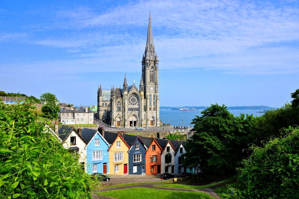 Colorful Deck of Cards houses in Cobh with St. Colman's Cathedral