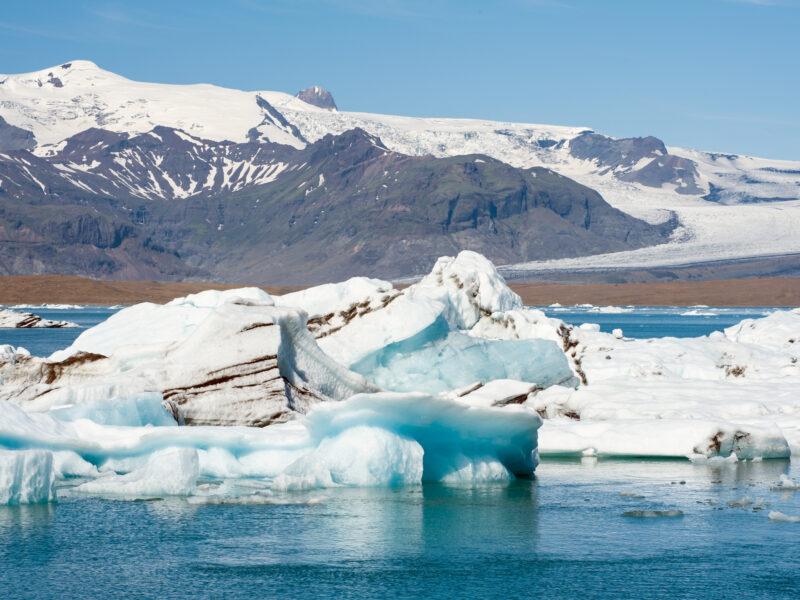 icebergs with Volcanic ash running through