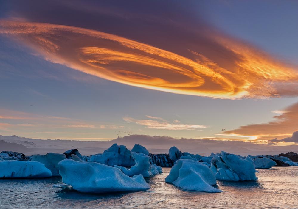 Unique cloud and sunset over glacier lagoon
